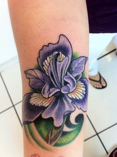 If I were to ever get a flower tattoo it would be an iris. The purple would be a darker shade than that used in this tattoo as to represent the majestic black iris. (Artwork by David Carbonell, Phat Joe's Tattoo Parlor, Miami, FL)
