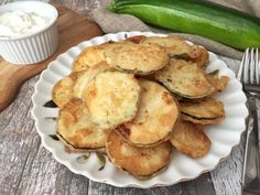 Zucchini (also called courgettes by people with lovely British accents) are funny vegetables; they kind of just creep up on you. If you have ever planted zucchini in your garden, we can bet the fa… Fried Zucchini Chips, Zucchini Rounds, Funny Vegetables, Leftover Wine, Spaghetti Meat Sauce, Vegan Dishes, Greek Recipes, Good Food, Fun Food