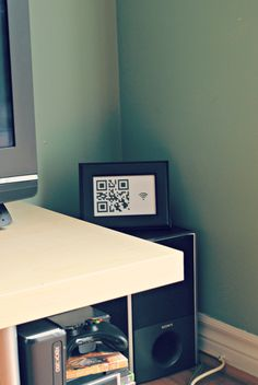 DIY QR code for WiFi password. Better than a sign & can keep out of the way so not just anyone can get it.