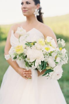 "From the editorial ""How to Make Your Micro-Wedding Feel Artfully Curated and Timeless."" With a lush color palette of wild greens, yellows, and a touch of white, along with the locally sourced flowers from family-owned farms in Virginia, this wedding was whimsical, effortless, and even had a glam feel! ✨ Photography: @nicolecolwellphotography #brideinspiration #weddingbouquet #classicbouquet #yellowbouquet #yellowflowers #weddingflowers"