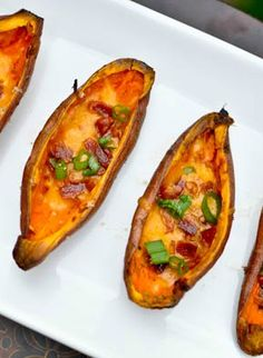 Loaded sweet potato skins are a slightly healthier take on regular potato skins and still topped with crispy bacon, cheese, scallions and greek yogurt! Potatoe Skins Recipe, Sweet Potato Skins, Loaded Sweet Potato, Real Food Recipes, Cooking Recipes, Yummy Food, Pub Food, Football Food, How Sweet Eats