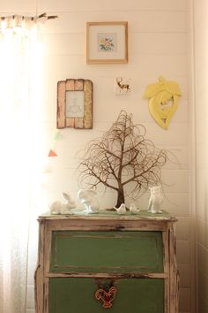 love that little tree ~ a branch & a small wooden base could easily recreate this sweet piece from the home of Claire of One Claire Day blog