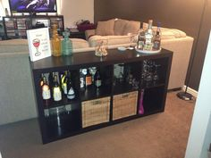 Home bar! Ikea expedit shelving turned on its side. Plus bar accessories.