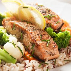 A very yummy recipe for moist baked salmon. served with rice and vegetables and garnished with green onions.