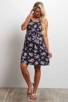 The perfect feminine maternity dress to make you feel beautiful day in and day out. A pretty floral print and sash tie detail will show off your bump effortlessly for every occasion. Simply style this dress with your favorite wedges and delicate necklace for a complete ensemble.
