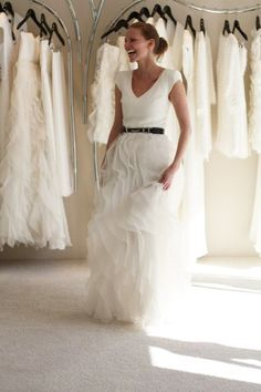 Love this look for a bride: t-shirt, ruffle drama skirt and belt. Casual glam.