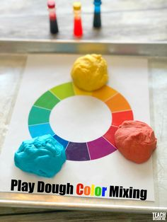 Learn the color wheel in a fun way with play dough color mixing! Perfect for a preschool rainbow unit. #rainbow #playdough #colorwheel #colormixing #preschool via @karyntripp