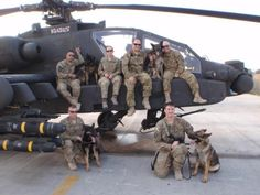 Brent Grommet and Matty, lower right, with their crew in Afghanistan.