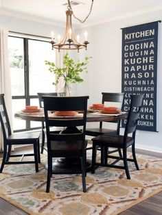 "Copy+This+Look:+Joanna+Gaines+accesorized+the+dining+area+with+a+banner+displaying+the+word+""kitchen""+in+a+dozen+languages.+For+a+similar+look,+stencil+a+piece+of+black+oilcloth+with+your+favorite+international+word+or+phrase."
