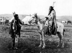 """Crazy Horse family members Floyd Clown & Doug War Eagle along with author William Matson discuss and sign their book """"Crazy Horse: The Lakota Warrior's Life and Legacy"""" based on the family's oral history. Photo is Scarleg, the warrior who shot Custer at the Little Bighorn, and Crazy Horse's first cousin Hump (on horseback)."""