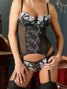 Cottelli Collection Basque Set with White Flowers £34.99 Cottelli Collection Basque Set . Very Pretty black Basque set with flower patterned details on front with matching thong.  www.townoftoys.co.uk
