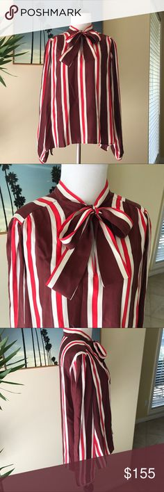 """Frame- Burgundy Multi Stripe Silk Tie-Neck Shirt So chic and perfectly on trend! Frame """"Burgundy Multi Stripe"""" silk tie-neck shirt. Bold stripes lend a polished finish and the self-tie neckline is a retro-modern detail. Length 21.5"""". Size medium. Brand new with tags attached. No trades please! Frame Denim Tops Blouses"""