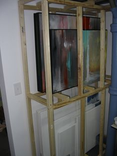 Great discussion thread showing how these were built, plus a few more!    I'm Building a painting storage rack - WetCanvas
