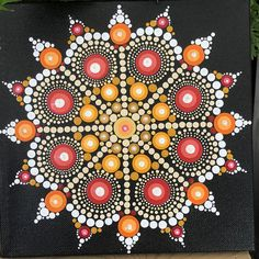 Hand painted dot mandala on a stretched canvas. Painted with acrylic paints. Black background with golds, yellows, reds, orange, cream and white dots. Mandala Canvas, Mandala Artwork, Mandala Dots, Mandala Painting, Mandala Pattern, Mandala Design, Dot Art Painting, Painting Patterns, Stone Painting
