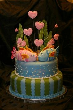 Kissing fish - I got inspired by a cake I found here on Cake Central but I used the concept as a cake topper instead of as a cake. The fish are molded out of rice cereal and covered in gumpaste. The rest of the decorations were made out of gumpaste.