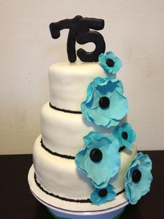 75th birthday cake with turquoise and black sugar flowers!