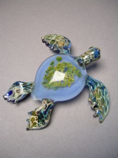 Sculptured Glass Sea Turtle paperweight swimming under the ocean with Anemone seaturtle shell