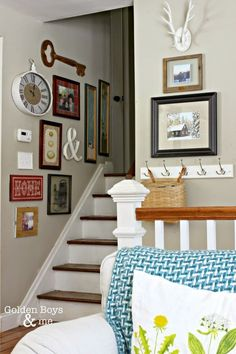 gallery wall going up staircase-www.goldenboysandme.com