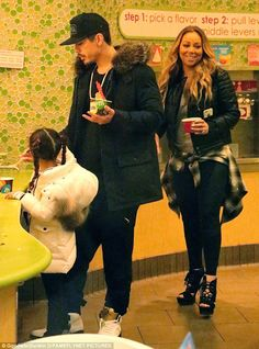 Treating themselves: Mariah Carey and boyfriend Brian Tanaka were spotted in LA on Thursday taking her twins Monroe and Moroccan out for frozen yogurt