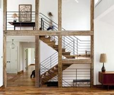 Sited on a former campground this beautifully renovated home by the designer Ritch Holben is a combination of traditional rustic and modern design based on a barn.