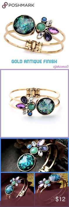 "⭐️GORGEOUS ANTIQUE GOLD BRACELET⭐️ 🆕GORGEOUS BRACELET IN AN ANTIQUE GOLD FINISH WITH GEMSTONES IN A FLOWER DESIGN. COLORS ARE PINK, PURPLE, BLUE, GREENS AND YELLOW. BANGLE STYLE. ABOUT 2.5"" ACROSS BUT CAN BE WORN MORE ""OPEN"" TO FIT A BIGGER WRIST. PERFECT ADDITION TO MOST ANY OUTFIT! ☑️BUNDLE & SAVE 20%☑️ Jewelry Bracelets"