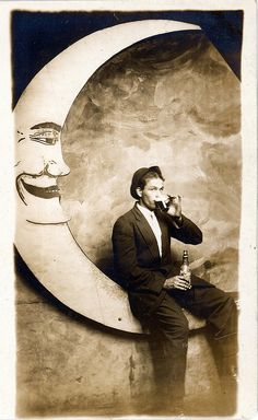 well dressed gent sipping beer on a paper moon