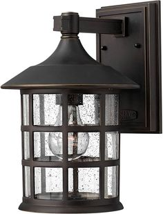 This 1-Light Energy Efficient LED Freeport Outdoor Wall Mount finished in Oil Rubbed Bronze and complemented in a Transparent Glass by Hinkley enhances your home with a fresh new look that's sure to p