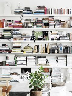 Floor to ceiling bookshelf filled with books and trinkets