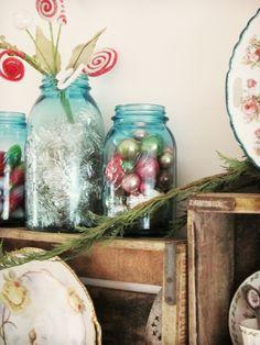 fill mason jars with mini ornaments and garland