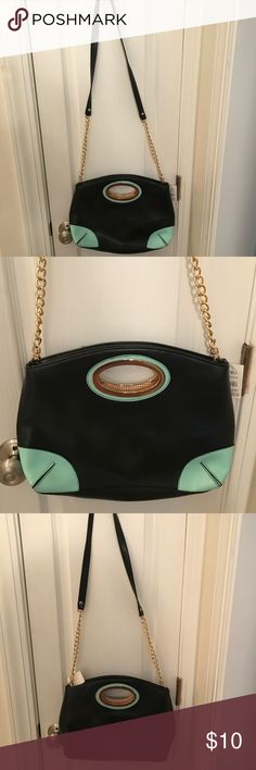 Cute satchel/ cross body bag black and turquoise Great black satchel / cross body bag perfect for a night out or every day use new with tags never been used black with turquoise and gold! Bags Satchels
