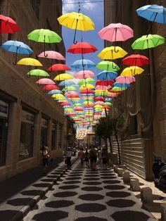 Umbrellas suspended over a side street in Jerusalem #imgur