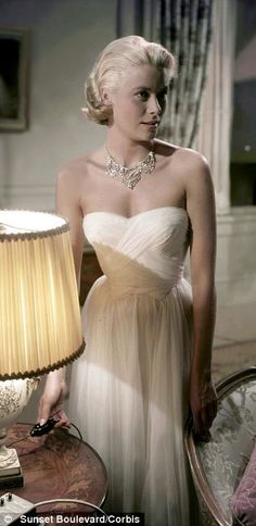 Grace Kelly in fabulous Edith Head gown,  'To Catch a Thief'. What a beautiful dress and woman