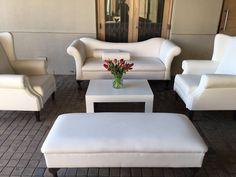 White lounge pocket set up with tulip floral arrangement