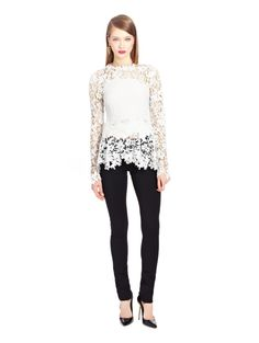 Oscar de la Renta:  Floral Guipure Lace Blouse ($2,390) A vision in white guipure lace, hand-cut floral appliques strike up the figure-flattering bodice, while a sheer-paneled neckline and sleeves deliver sensual drama to the embroidered silhouette.