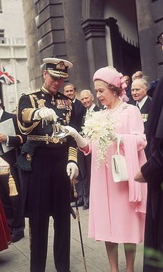 Queen Elizabeth II and Prince Philip admire a silver bell on the occasion of Her Majesty's Silver Jubilee in 1977. Photo: Getty Images