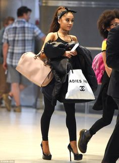 Ariana Grande in Cute Head-Scarf and Sky-High Stilettos for Plane Ride | Buy ➜ http://shoespost.com/ariana-grande-saint-laurent-tribute-pumps-airport/