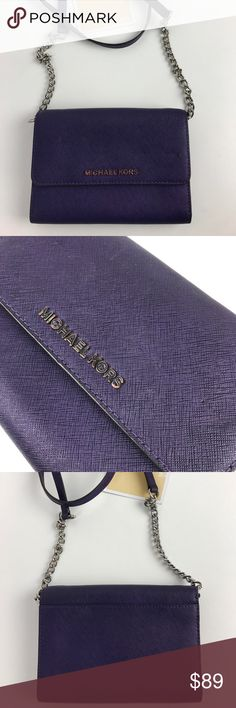 """Michael Kors Jet Set Travel Large Phone Crossbody Authentic. Gently used. A few tiny pinholes in flap, otherwise in very good condition.  Silvertone logo letters polish the scratch-resistant Purple Saffiano leather of a chain-strap crossbody designed with a well-organized interior including a handy cell-phone compartment. 4.5""""H x 6.5""""W x 1.5""""D; 22"""" strap drop. Style 32T4STVC3L. RB465.   Thank you for your interest!  PLEASE - NO TRADES / NO LOW BALL OFFERS / NO OFFERS IN COMMENTS - USE THE…"""