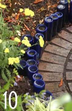 Awesome idea for edging the garden with the glass that they don't recycle in Alaska!!