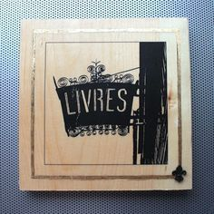 """New to dustonmyboots on Etsy: City of Delight #23 """"Livres"""" book store sign in Paris OOAK handmade 8x8"""" photo print (toner gold leaf beeswax wood block) (75.00 CAD)"""