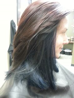 Chocolate hair color with red highlights, with blue underneath. Aveda color.