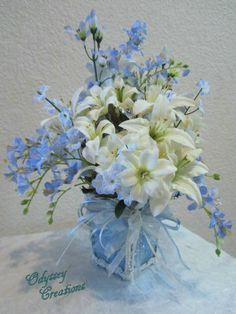 flowers arrangement light blue white | Floral Arrangement in Baby Blue with White Lilies and Butterflies with ...