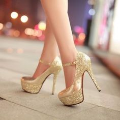 Gold High Heeled Stilettos with sparkling platform and heel, narrow ankle strap, and rounded vamp and toe for these precious metal trending style shoes.