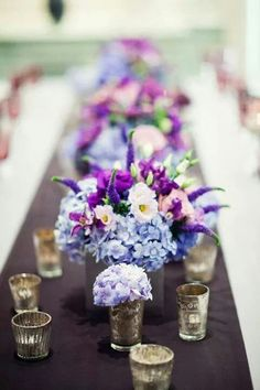 Beautiful light blue purple hydrangea and bright orchid purple flower centerpieces.