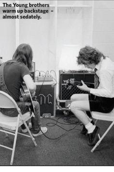 Malcolm and Angus Young, backstage