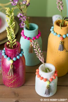 This DIY is for everyone! Paint glass jars with your favorite colors, and use a separate brush to splatter a corresponding color on top. Add beads and tassels for extra pizzaz!