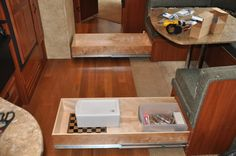 great idea!  pull out drawer mod for under the dinette storage.  drawer slides are not cheap but seems they would pay for themselves in just one camping season!!