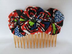 African fabric yoyo flower hair comb by MildredsClosetUK on Etsy, £3.50