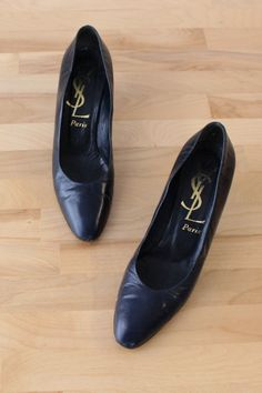 Classic soft navy blue leather pumps by Yves Saint Laurent with chic tapered almond toe, reptilian embossed medium high heel and smooth leather insole. Marked YSL Paris, made in Italy, circa Vintage Ysl, Vintage Skirt, Vintage Leather, Navy Pumps, Blue Heels, Ysl Paris, Prairie Skirt, Tent Dress, Leather High Heels