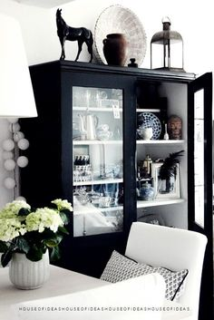 HOUSE of IDEAS Black cabinet - I like the idea of a treasure cabinet, for all your small findings and memories.