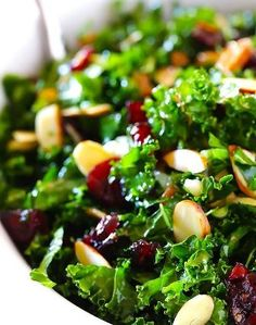 Kale Salad with Warm Cranberry Vinaigrette -- easy, healthy, and so tasty. It's a recipe everyone will love!